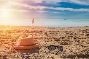 Sunglasses on sandy beach in a