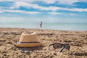Sunglasses on sandy beach in a
