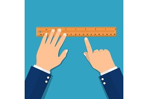 Plastic measuring ruler in hand.