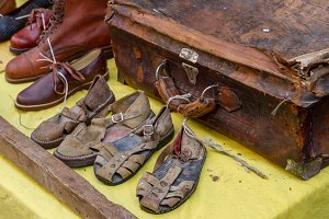 Very old shoes and suitcase