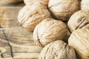 Walnuts on dark vintage wooden