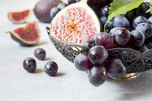 Fresh figs and black grapes with