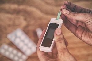 Hands testing blood sugar