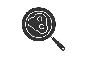 Fried eggs on pan glyph icon