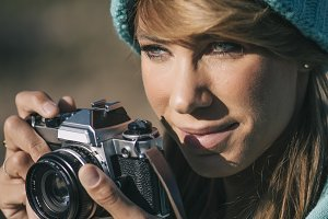 Pretty woman with hat taking picture