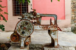 Old rusty machine located in a garde