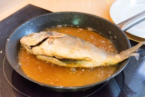 Fried fish on a pan