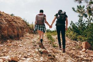 Explorer couple trekking a hill
