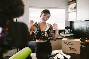 Woman making new sportswear video