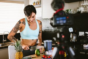 Woman creating a vlog about healthy