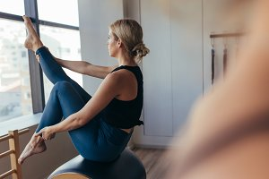 Pilates woman training at the gym
