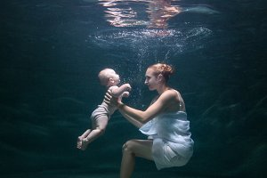 Mom and her baby are under water.