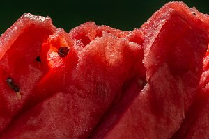 A red fresh watermelon sliced into