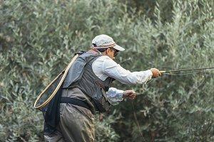 Fly fisherman using flyfishing