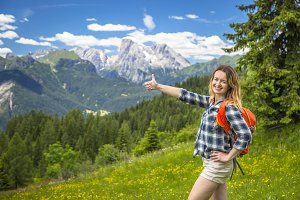 Happy woman trekking in Alps