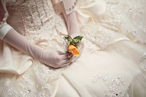 Bride Holding Small Flower
