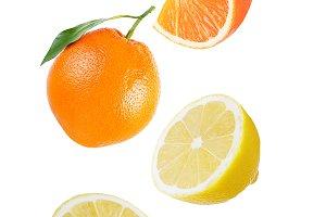 Flying orange and lemon isolated on