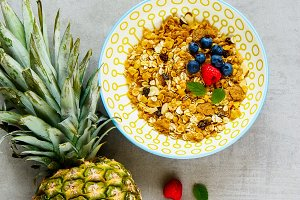 Granola, pineapple and berries