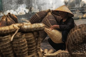 Closeup Old Vietnamese female crafts