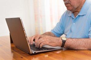 senior man working on laptop