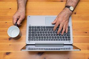 Senior man working with laptop.