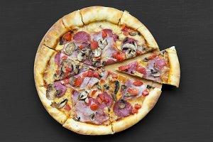 Freshly baked pizza on black