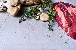 Raw beef steaks,herbs and cooking