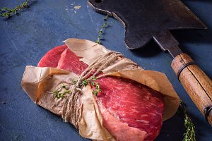 Raw meat, beef steak on dark table
