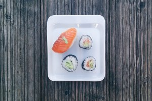 Pieces of sushi on small plate