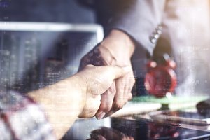 businesspeople shake hand