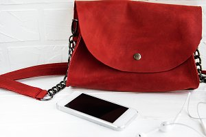 Red leather bag and phone
