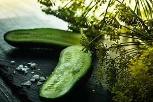 Fresh green cucumber with salt and d