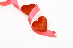 Two hearts and red ribbon