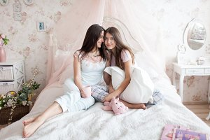 Mother and daughter in light bedroom