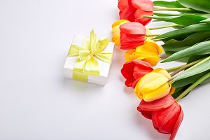 White gift box with yellow ribbon