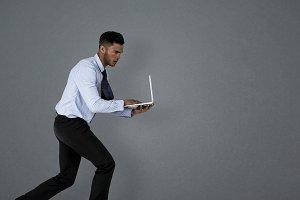 Man using laptop while running