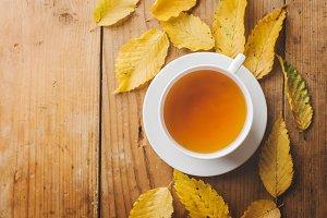 Autumn tea on wooden table