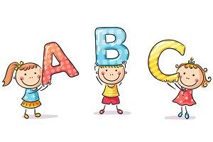 Little kids holding ABC letters