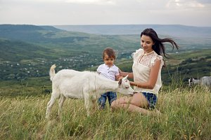 woman with a child in a field on the