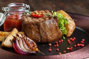 steak medallion. restaurant food