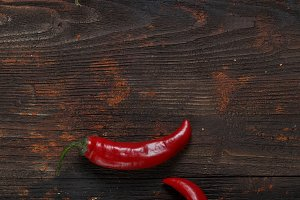 Red hot chili peppers on old wooden