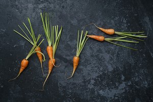 Fresh Carrot on a wooden background.