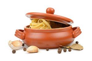 Spaghetti in a clay pot