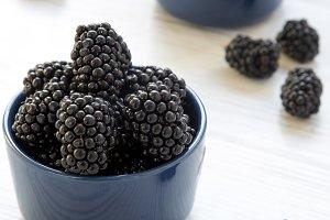 Blue bowls full of blackberries