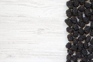 Blackberries on white wooden table