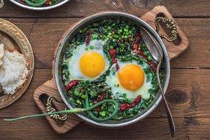 Green shakshuka. Fried eggs with