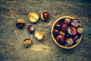 Fresh chestnuts on the old wooden