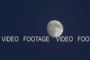 The moon in dark night sky
