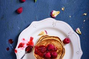 Stack of american pancakes raspberry