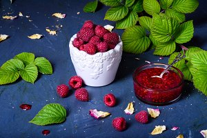 Raspberry jam with fresh berries,